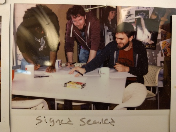 """Signed Sealed."" Photo of a polaroid."